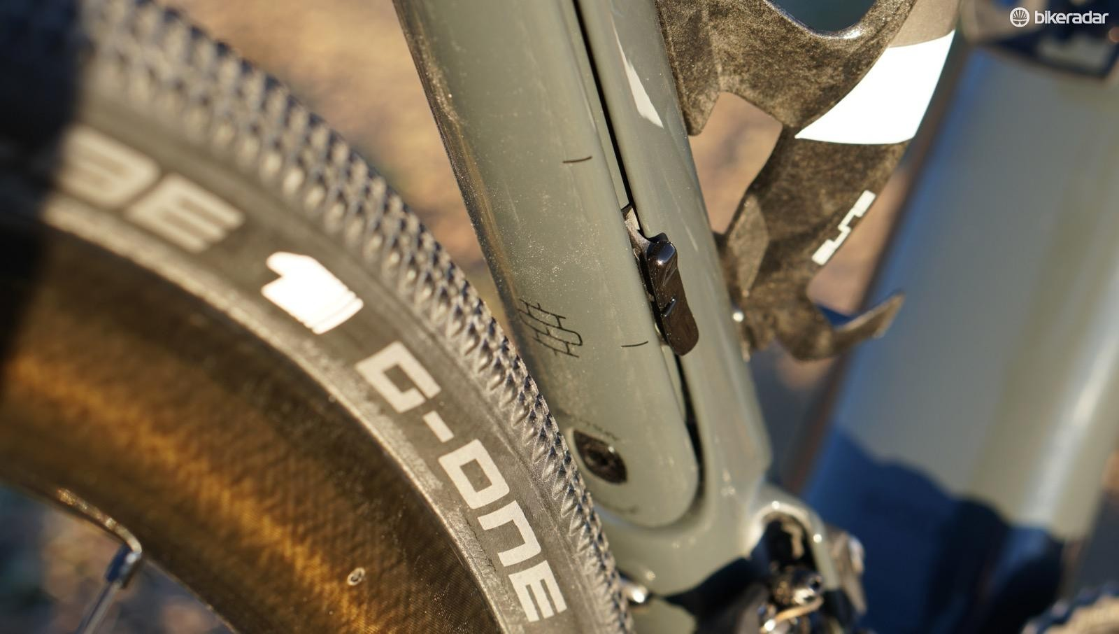 This Domane SLR features adjustable rear isospeed. But shouldn't there be a little gravel rock icon instead of cobbles?