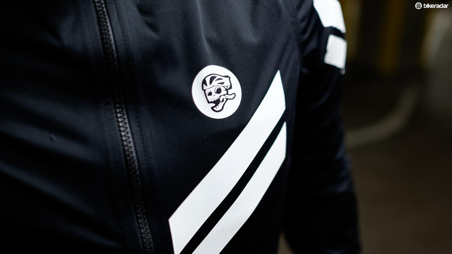The white details on the jacket offer reflectivity to an otherwise black garment