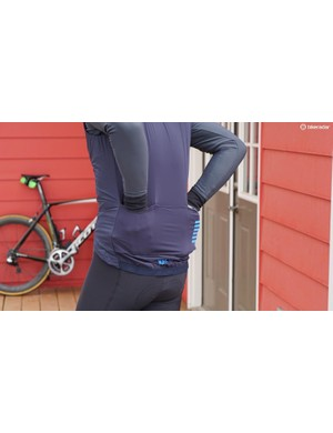 The back is stretchy and breathable, with three standard pockets and one zippered compartment