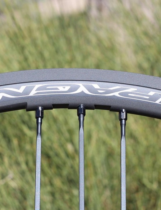 The wheels have 16 front and 21 rear spokes in Campy's Mega-G3 lacing pattern