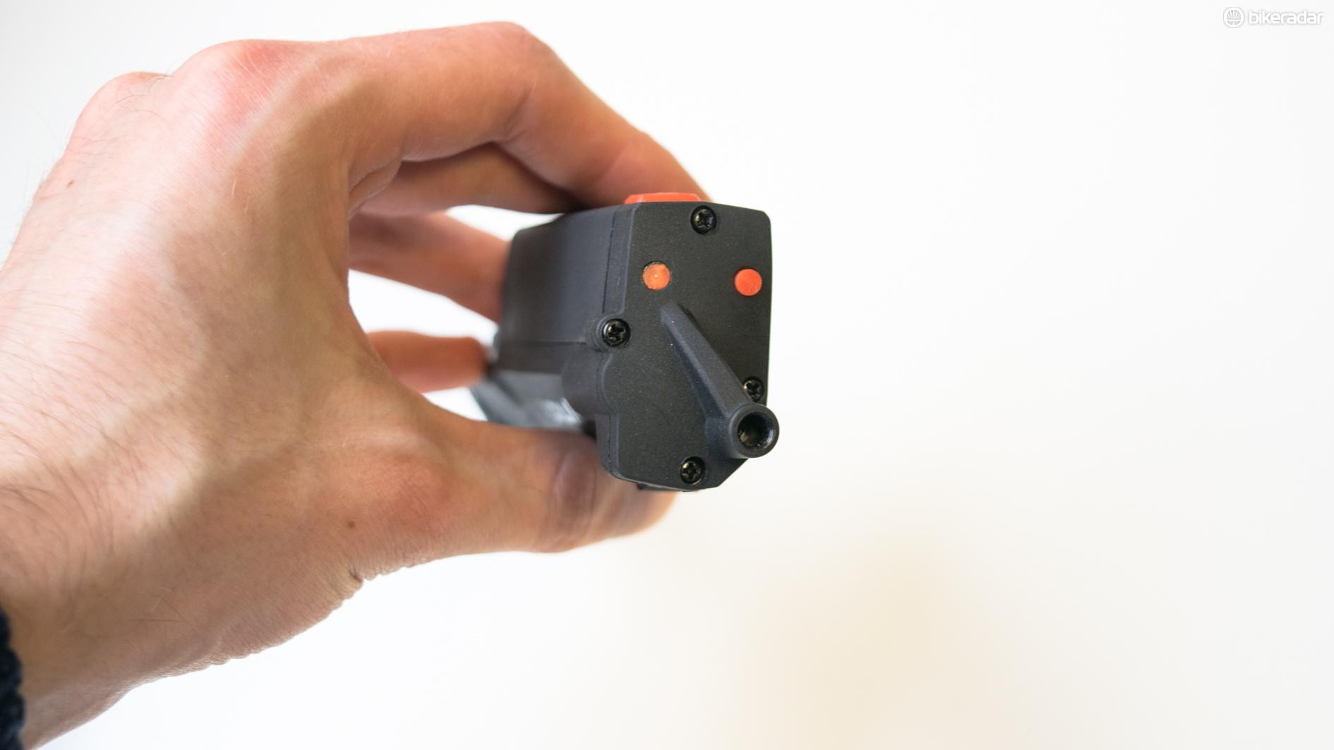 The E-Link mounts near your derailleur, and a cable emerges from that hole