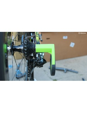 The Bopworx protector works by opening and loosening your quick release, sliding the flat steel arms between the frame and the cassette, then clamping the quick release back down