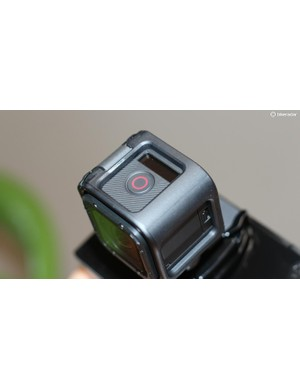 The red button turns the camera on and starts recording with a single push
