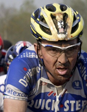 Belgium's Johan Museeuw (C) (Quick Step) rides on a cobblestone road during the 102nd Paris-Roubaix cycling race, 11 April 2004.