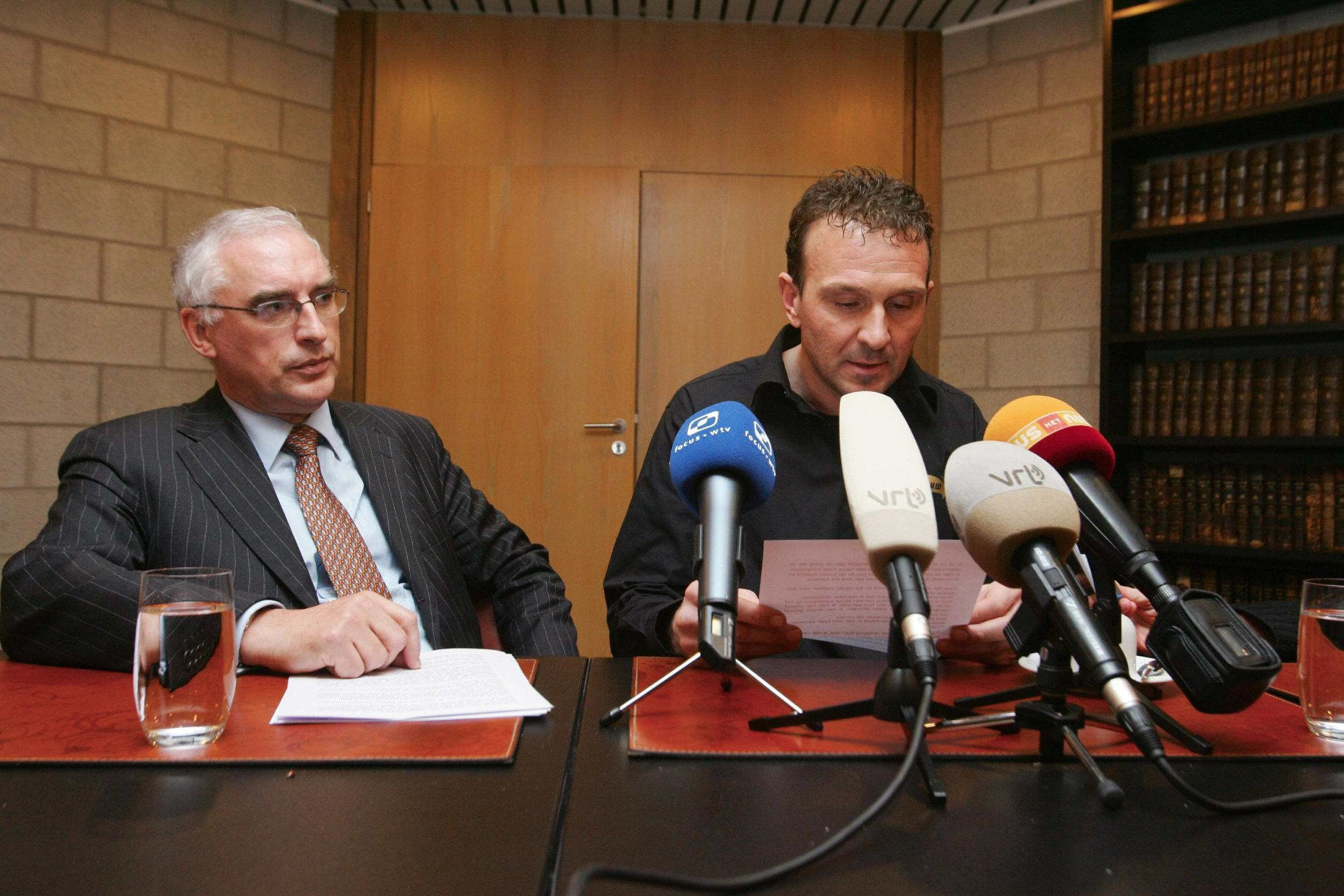 Former cyclist Belgian Johan Museeuw (R) gives a press conference next to his lawyer Jozef Lievens (L), 23 January 2007 in Kortrijk, in which he admitted to have used doping products during his cycling years.