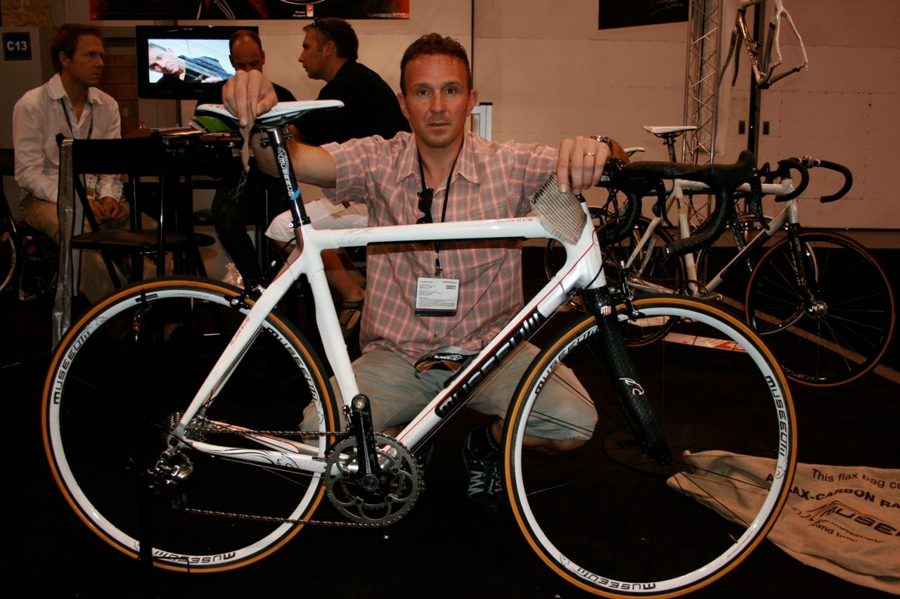 Johan Museeuw poses with his flax carbon bike in his booth at the 2008 Interbike Show in Las Vegas.