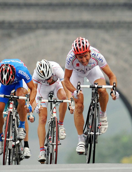 Spaniard Samuel Sanchez (L) takes Olympic gold in the men's road race in Beijing, ahead of Davide Rebellin (C) and Fabian Cancellara (R).