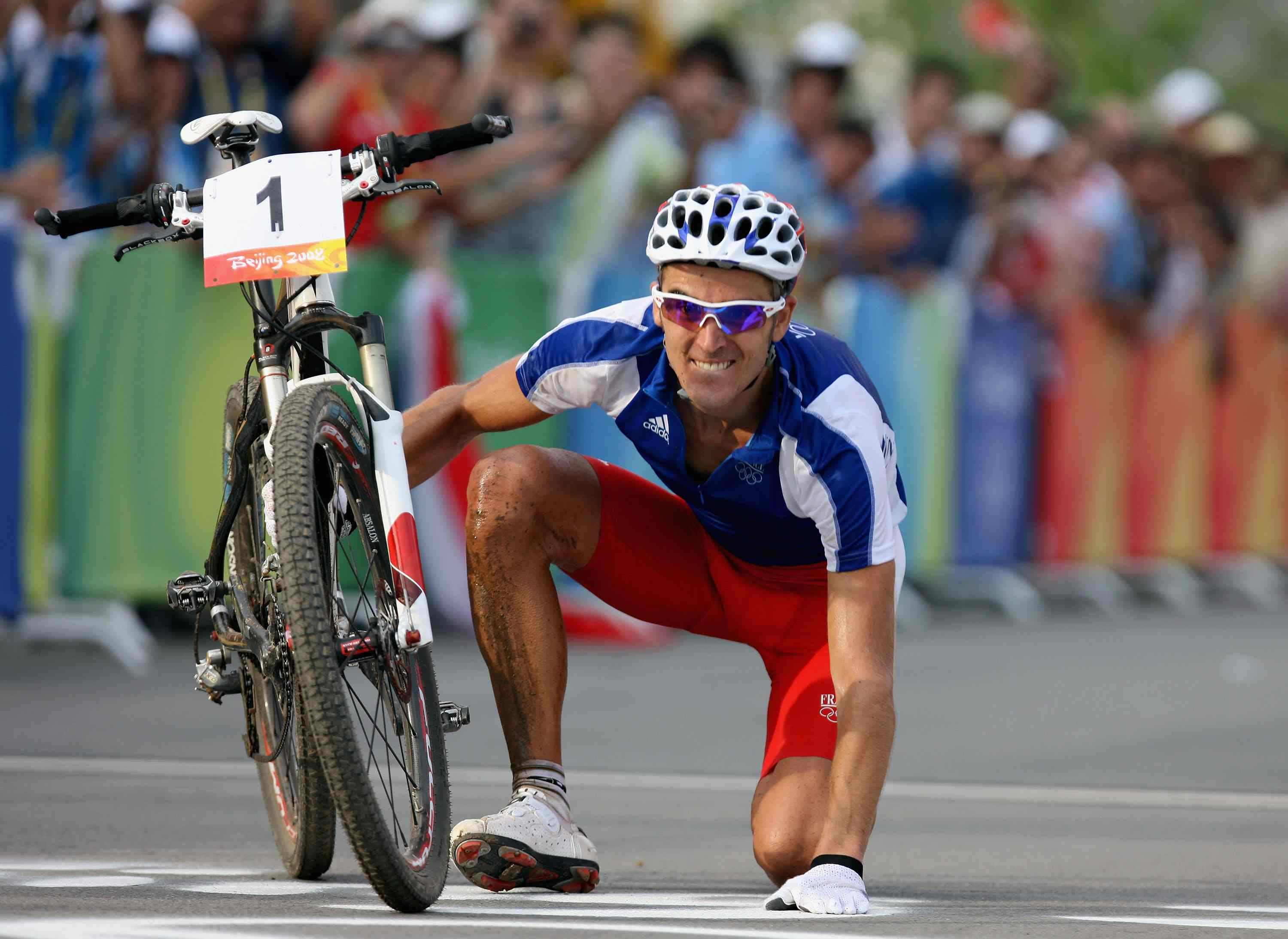 Julien Absalon of France celebrates victory in the Men's Cross Country mountain bike cycling event held at the Laoshan Mountain Bike Course on Day 15 of the Beijing 2008 Olympic Games on August 23, 2008 in Beijing, China.
