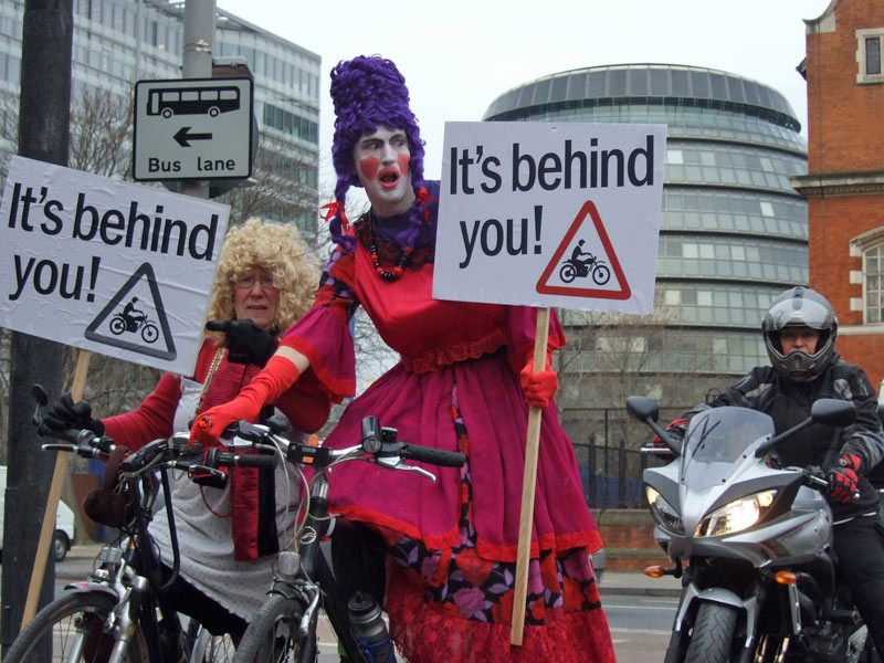 It's behind you! London Cycling Campaign members dressed as panto dames warn fellow cyclists to watch out for motorbikes in bus lanes from Monday 5th January