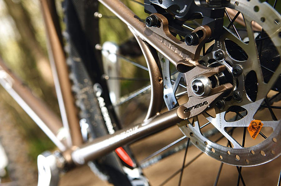 Track-style rear facing slot dropouts keep chain tension