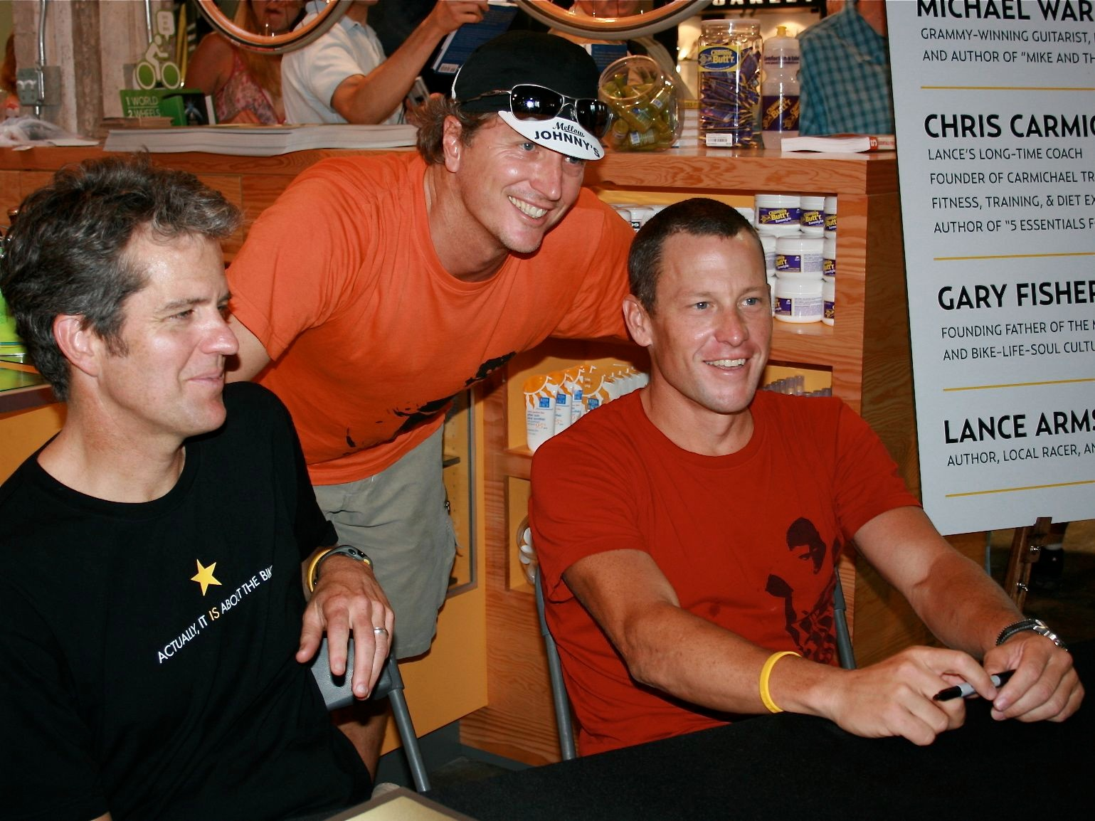 Business partners and friends: Bart Knaggs (C) and Lance Armstrong at the Mellow Johnny's bike shop opening in May, 2008.