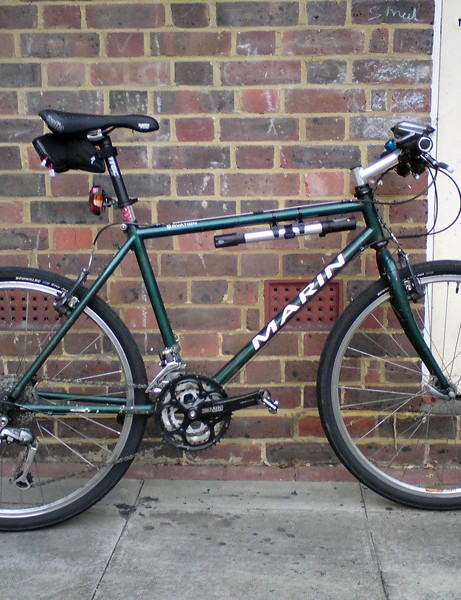 snooks's wolf-in-rusty-sheep's-clothing '94 Marin, slick Schalbe City Jets, 48-tooth chainring, flat sawn-off bars, spds, Sella Itallia flite, gel max flow thingy (comfy), go faster Diet Coke seat post shim