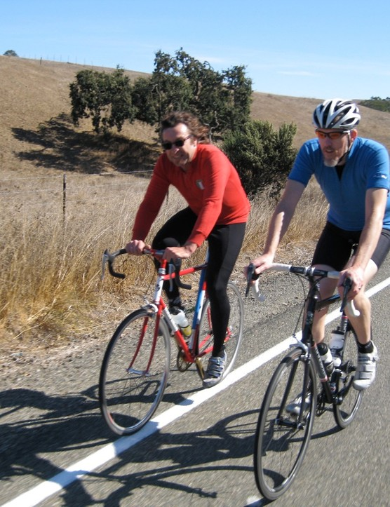 Salsa founder Ross Shafer (L) wearing a top secret big-hair helmet, sharing saddle time in Marin County with Mike Varley.