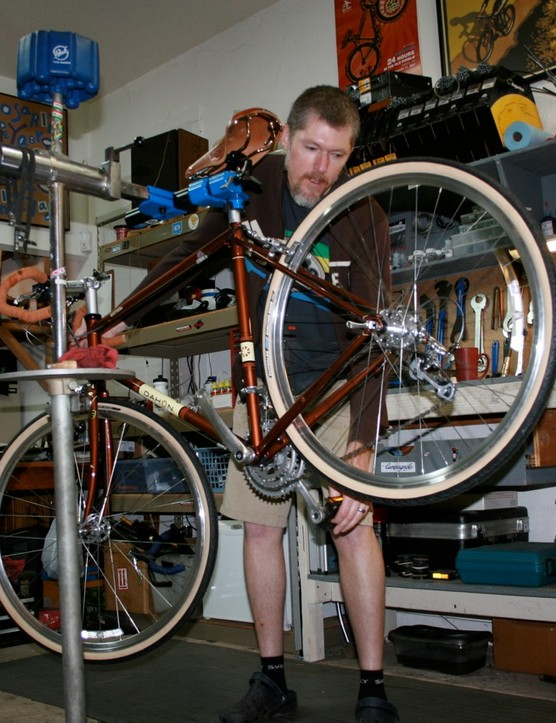 Once a mechanic, always a mechanic: Varley and his trusty Park Tool repair stand.