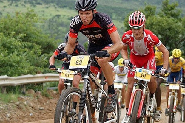 South African Under-23 road race champion, Jacques Janse van Rensburg, leads the front group up a climb early on in the Elite men's ultra-marathon.