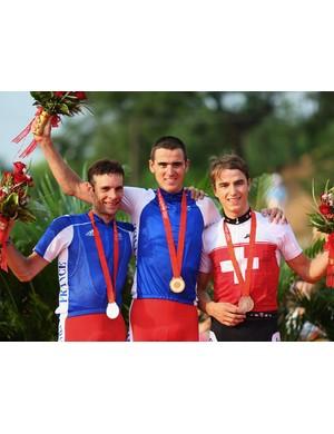 Peraud, left, on the podium at last summer's Olympics