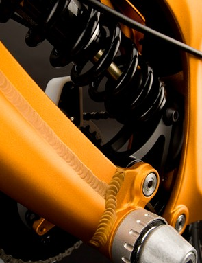 A reinforcing rib runs all the way from the base of the abbreviated seat tube around to the bottom bracket shell.