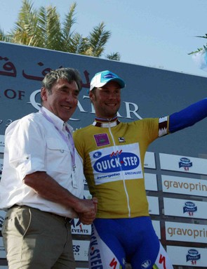 Tom Boonen (R) of QuickStep poses with Belgian cycling legend Eddy Merckx after winning the golden jersey after Stage 3 of the Tour of Qatar in Doha, on February 3, 2009.