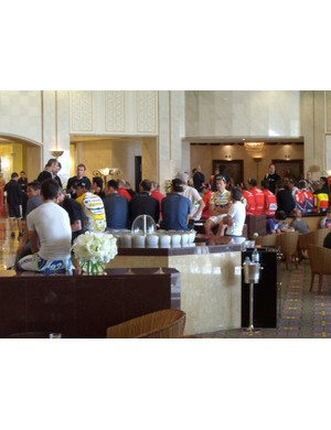 Shocked riders and team staff wait in the lobby of the Ritz-Carlton Doha hotel for more news on the death of Topsport rider Frederiek Nolf
