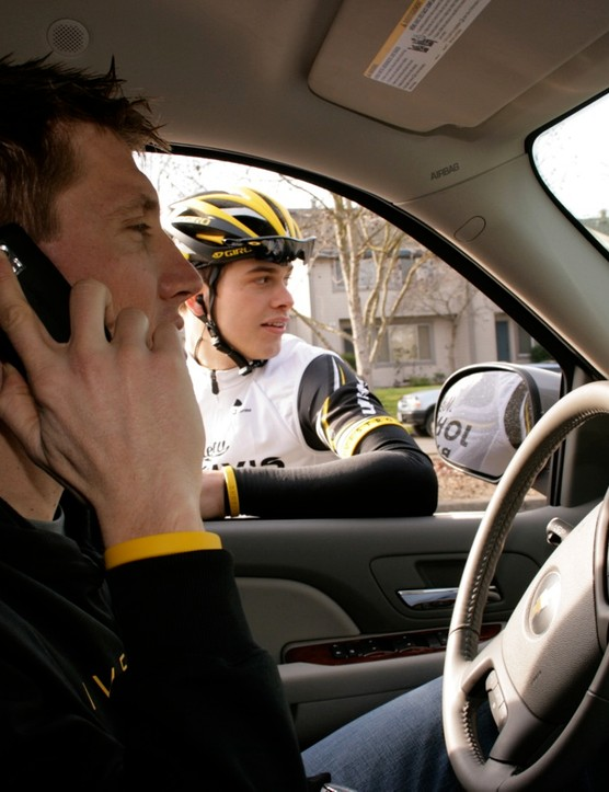 Merckx is wondering where Taylor Phinney is, as teammate Bjorn Selander waits patiently.
