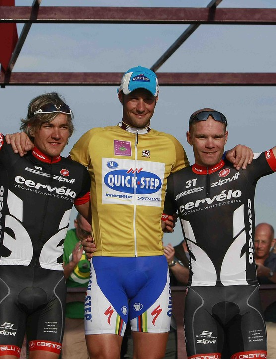 Germany's Heinrich Haussler, Belgium's Tom Boonen and Britain's Roger Hammond wave on the winners' podium after the final stage of the Tour of Qatar cycling race in Doha on February 6, 2009.