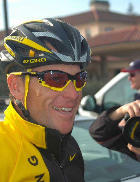 Lance Armstrong greets the media before heading out for a team ride in Santa Rosa, California.