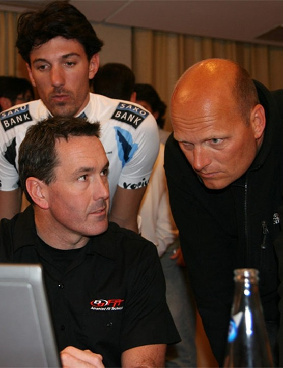 Holz, Bjarne Riis and Cancellara view the data
