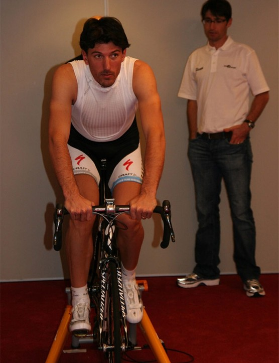 World time trial champion Fabian Cancellara during his assessment. Recently retired pro Bobby Julich is watching