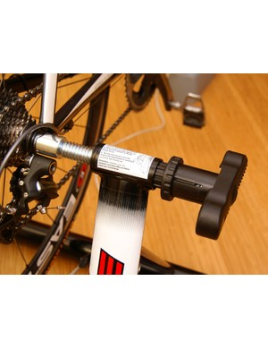 The single-sided axle mount is easy to use and locks securely in place though it flexes more than we'd like