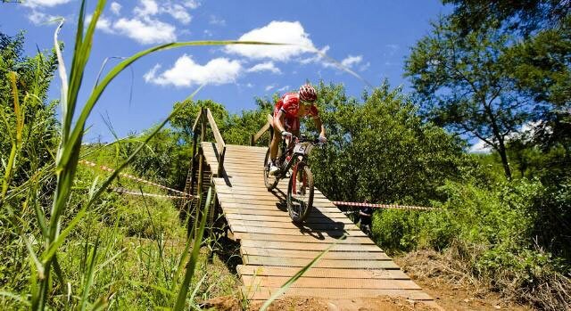 The lush Mpumalanga bushveld at Mankele provided the perfect setting for the second round of the MTN National Cup. Here eventual winner, Burry Stander negotiates one of the many wooden bridges on the course