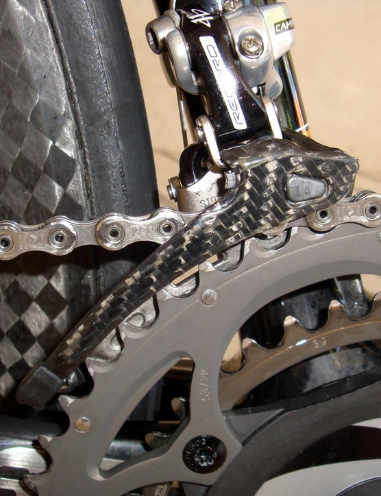Campagnolo says the stiffer front derailleur cage provides smoother shifts and though narrower, the chain is supposedly stronger than before.