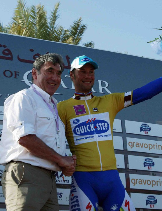 Belgian cycling greats Eddy Merckx (L) and Tom Boonen on the podium of the 2009 Tour of Qatar.