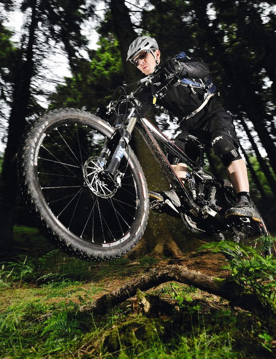 Push through the bike with hands and feet to clear obstacle on the trail