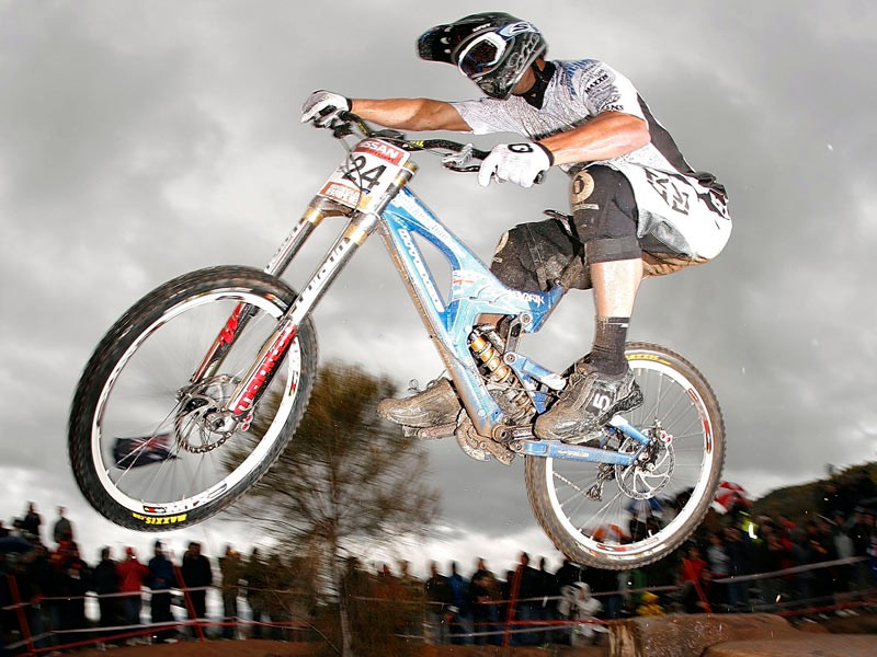 Chris Kovarik in action in the semi final of the Men's Downhill event during day two of the MTB World Cup held at Mount Stromlo August 31, 2008 in Canberra, Australia