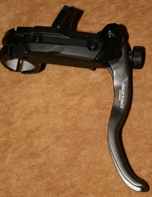 The Deore brake lever now features a hinged clamp and tool-less reach adjuster