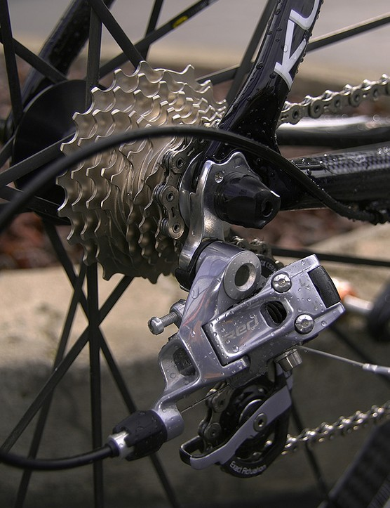 A SRAM Red rear derailleur moves the chain 	over the innovative OG-1090 cassette.