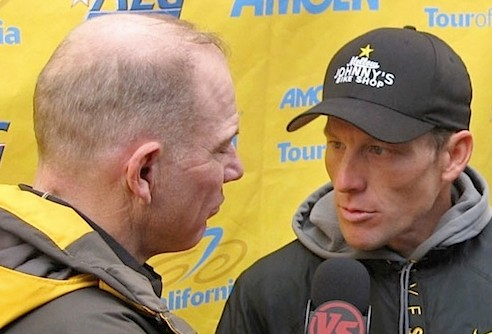 Bob Roll and Lance Armstrong appear to be puckering up toward a kiss in California.