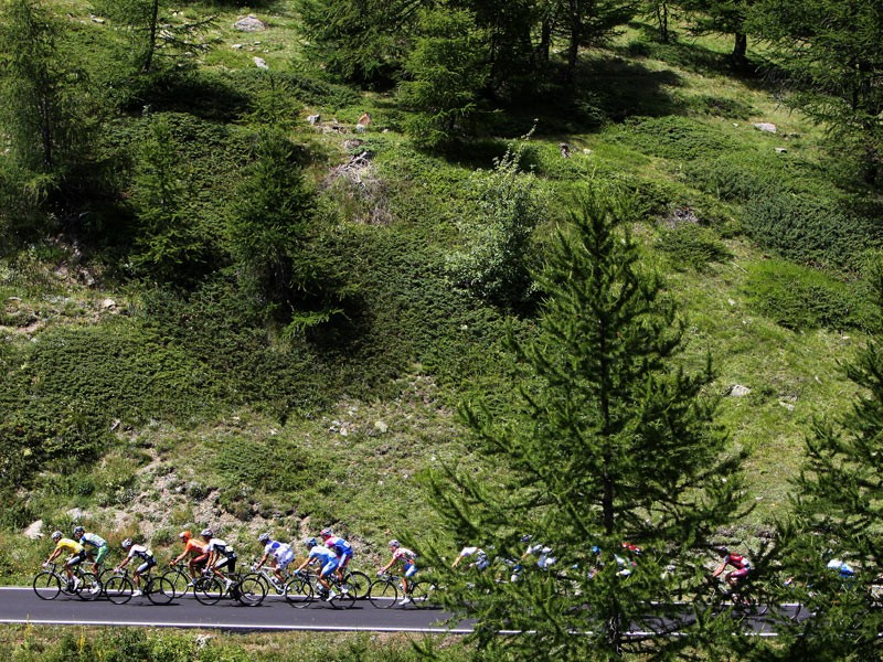 Race leader Frank Schleck of Luxembourg and Team CSC Saxo Bank rides with the peloton in the yellow jersey up the Col de la Lombarde during stage 16 of the 2008 Tour de France from Cuneo to Jausiers on July 22, 2008 in Jausiers, France