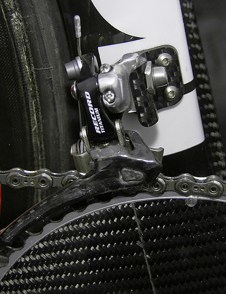 The front derailleur is bolted to a carbon mount.