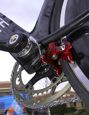 The rear brake is mounted behind the chain stays right behind the bottom bracket.