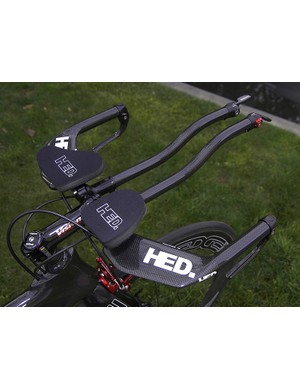 Bolted to the frame is a variety of top-end aero gear including the HED Black Dog Flat integrated bar.