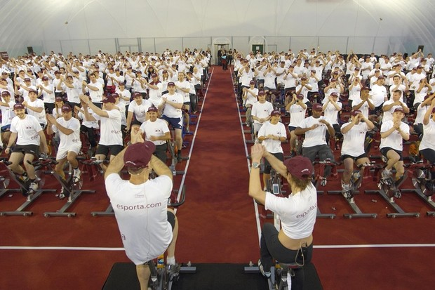 Esporta's CEO Glenn Timms and fitness instructor Anna Lovelock lead 410 employees as they cycle into the record books