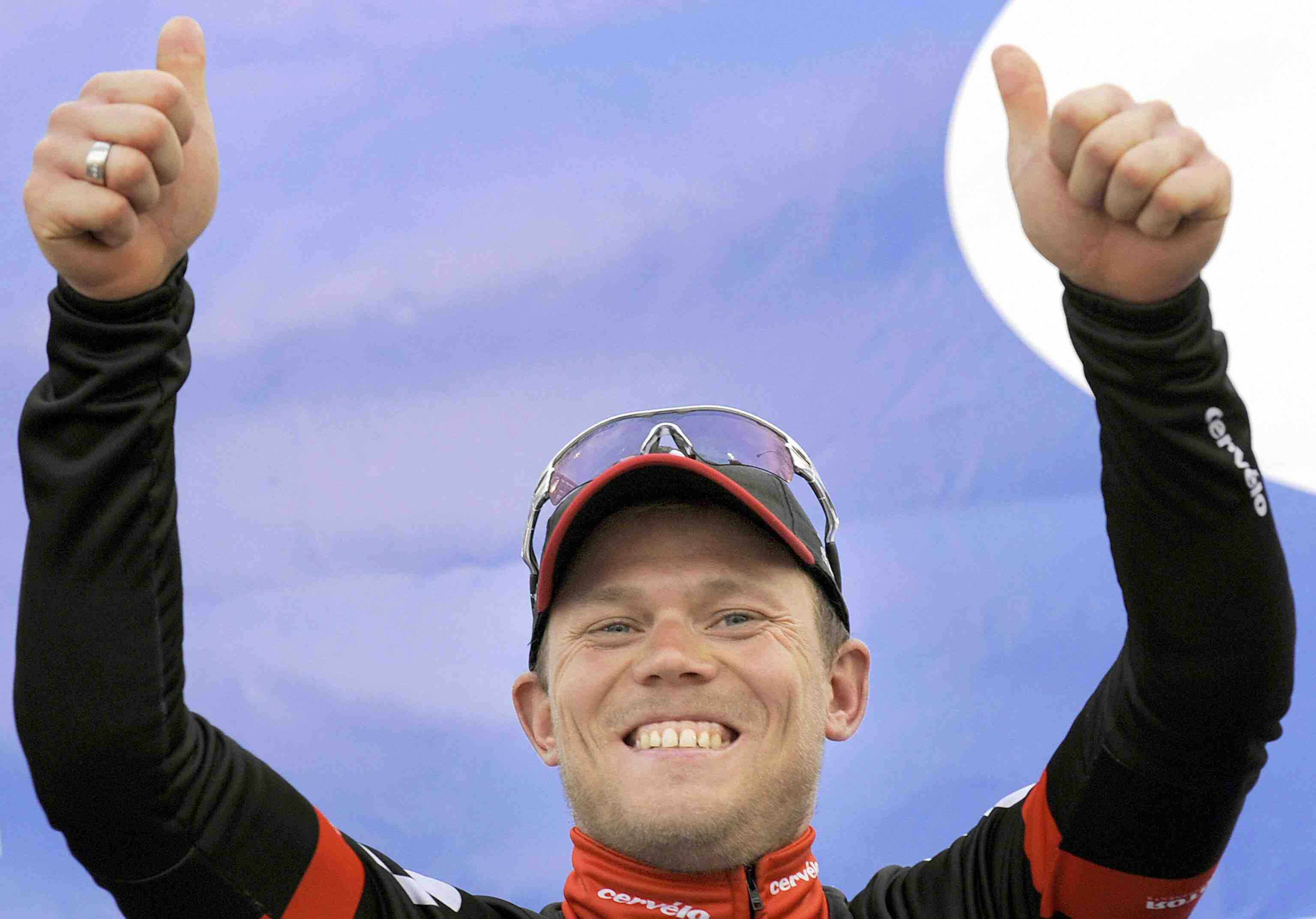 Norwegian cyclist Thor Hushovd of Team Cervelo celebrates on the podium after winning the Omloop Het Nieuwsblad road cycling race on February 28, 2009.