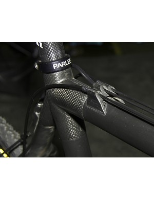Carbon fiber top tube housing stops are molded as a strip and then individually cut and milled.