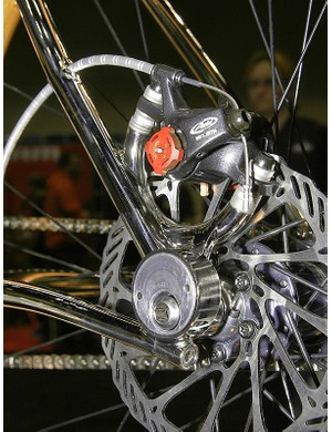 A small eccentric allows for tensioning the chain and concentric axle pivots are also hidden behind them.