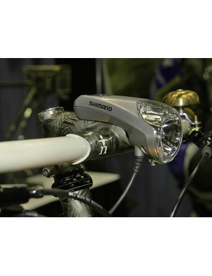 The Shimano generator-power front light is perfectly mated to the custom stem.