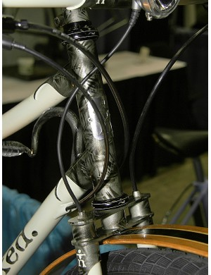 The front brake line and generator wire are both fed into the top of the fork blades.