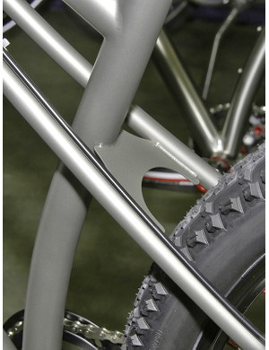 The seat stays are anchored to the seat tube with a tiny titanium plate.