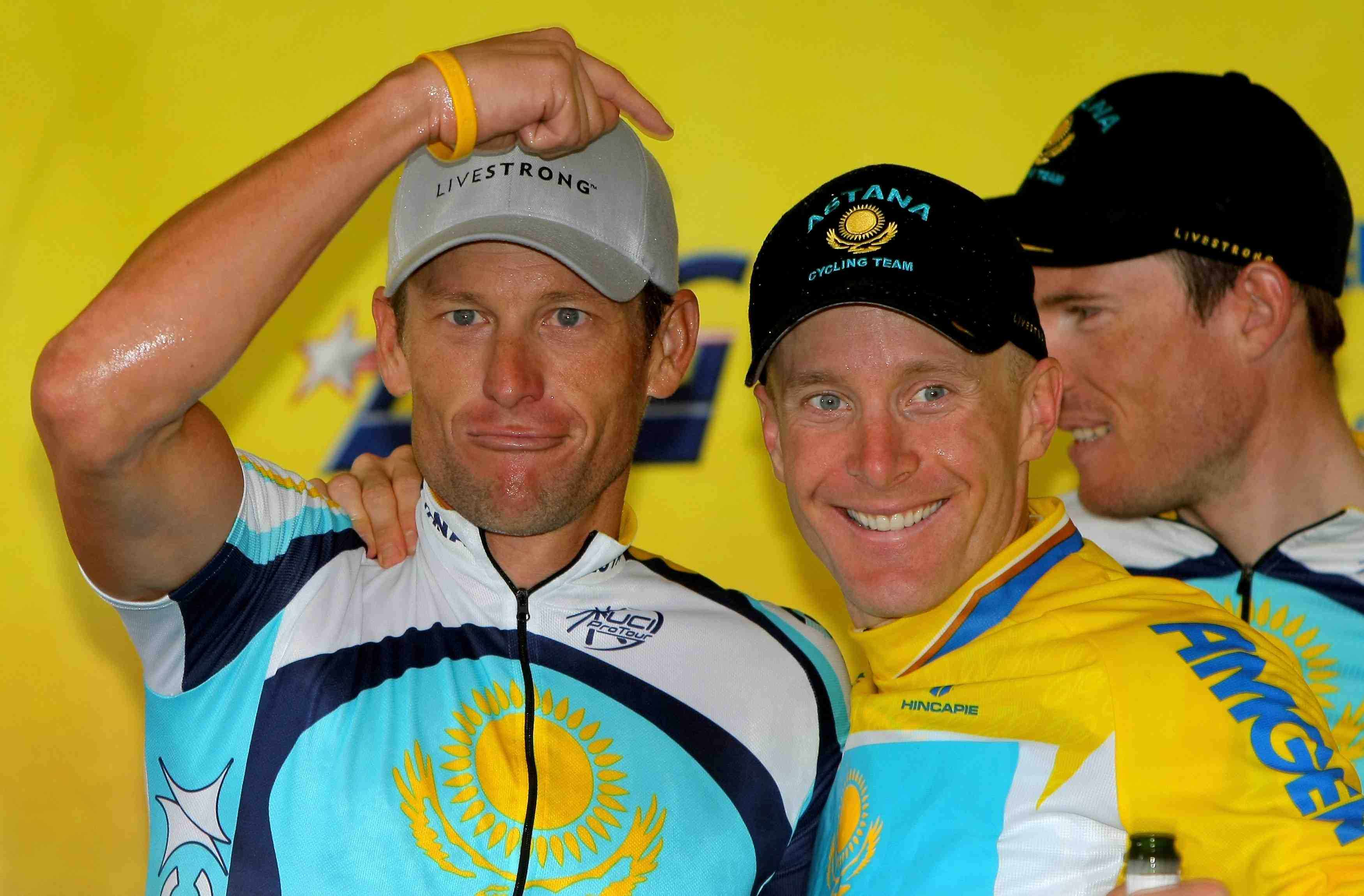 Lance Armstrong gestures to teammate Levi Leipheimer on the final Tour of California podium February 22, 2009.
