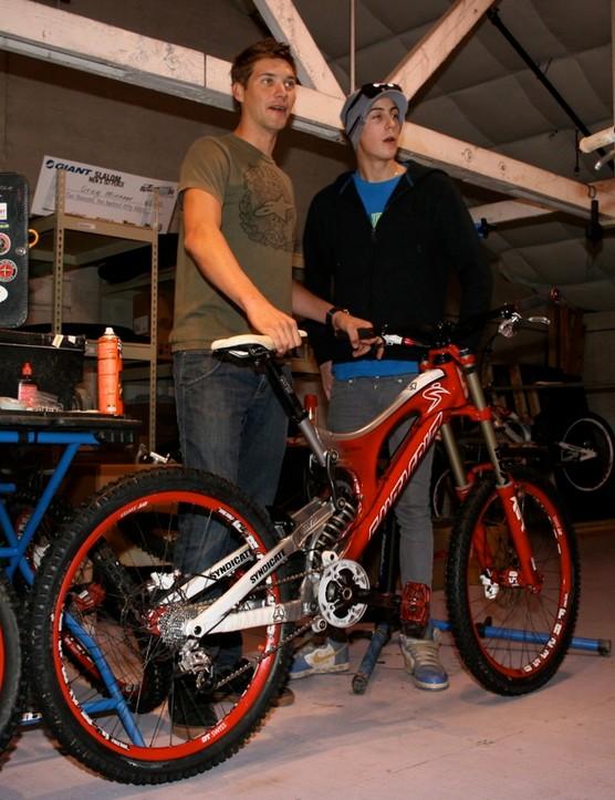 Santa Cruz Syndicate teammates Greg Minnaar (L) and Josh Bryceland with the latest V-10 team issue race bike.